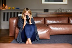 cold-woman-with-blanket-and-coffee